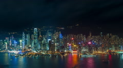 Hong Kong at night time lapse. Panoramic island view with city lights reflection - stock footage