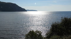 Old Woman Bay. Sun reflections. Stock Footage
