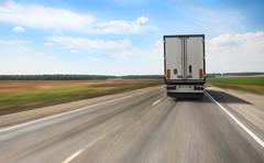 truck goes on highway - stock photo