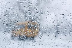 winter road through wet windshield - stock photo