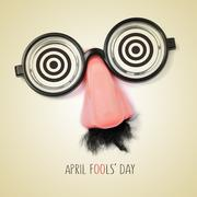 fake eyeglasses and text april fools day, with a retro effect - stock illustration
