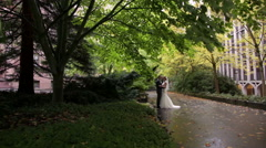 Bride and groom hugging in the park Stock Footage