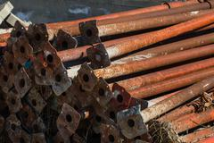 old scaffold tubes storaged outside in a pile - stock photo