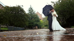 Bride and groom under the umbrella Stock Footage