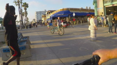 Viewpoint Riding Bike On Venice Beach Boardwalk Stock Footage