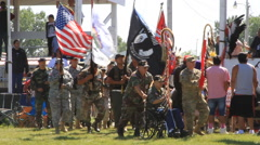 Veterans lead pow wow grand entry Stock Footage