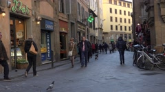 ULTRA HD 4K Tourist people relax narrow street old town Florence shopping street Stock Footage