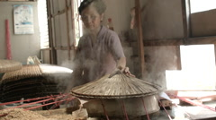 A woman making rice paper at a confectionary in Vietnam Stock Footage