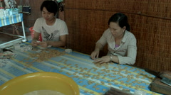 Factory workers packing coconut candy in Vietname Stock Footage