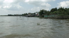 The banks of the Mekong River as seen from a boat in Vietnam Stock Footage