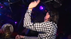 Dj playing and dancing in nightclub. Grid grille Stock Footage