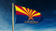 Arizona flag slider style with title. Waving in the wind with cloud background Stock Footage