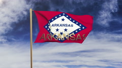 Arkansas flag with title waving in the wind. Looping sun rises style.  Animation Stock Footage