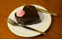 Chocolate cake on white plate - stock photo
