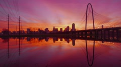 4k UHD Dallas Skyline sunrise w/ margaret Hunt bridge and reflecitions in river Stock Footage