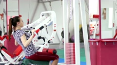Beautiful girl hard training in gym - stock footage