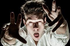 Crazy Man Acting like a Zombie Stock Photos