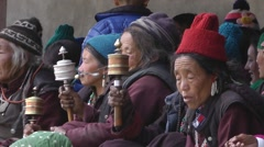 Older spectators with praying wheels,Lamayuru,Ladakh,India Stock Footage