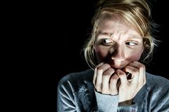 Woman Afraid of something in the Dark Stock Photos