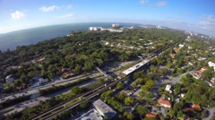 Aerial drone video I95 Frost Art Museum approach - stock footage