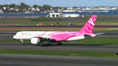 Delta Airlines pink ribbon Boeing 757 airplane taxies Stock Footage