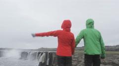 Happy hiking people in Iceland Selfoss waterfall - hikers having fun Stock Footage