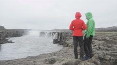 Couple taking selfie photo smartphone in Iceland by Selfoss waterfall Stock Footage