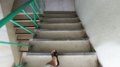 Walk down the stair - stock footage