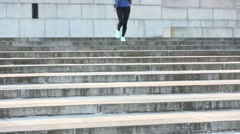 Girl exercises on steps Stock Footage