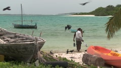Climate change front line - fishermen on Maldives beach with fish and child Stock Footage