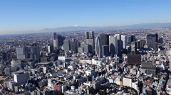 Mt Fuji and Shinjuku buildings  Aerial view from Helicopter Stock Footage