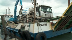 Cement mixer truck on floating barge during waterside construction work Stock Footage