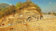 The construction of the road with difficulty. Stock Footage