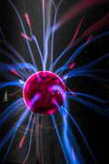 Plasma ball  with magenta-blue flames isolated on a black background. - stock photo
