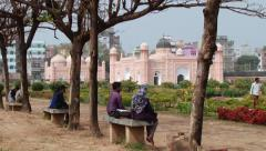 People enjoy their visit to the Lalbagh fort in Dhaka, Bangladesh. Stock Footage