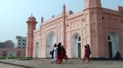 People pass Mausoleum of Bibipari in Lalbagh fort in Dhaka, Bangladesh. Stock Footage