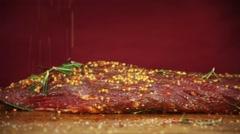 Cook meat paprika sprinkles - stock footage