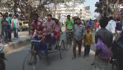 Rickshaws drive by the street in Dhaka, Bangladesh. - stock footage