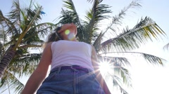Woman Enjoying Beach Holidays and the Sun against Palm Tree Stock Footage