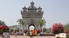 Monks making a photograph in front of Patuxai,Vientiane,Laos Stock Footage