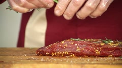 Prepared and peppered meat sprinkled with herbs Stock Footage
