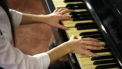 Girl takes a beautiful melody on the piano - stock footage