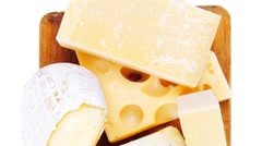 Various types of cheese on wood Stock Footage