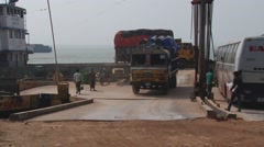 Tata truck disembarks from the ferry boat at the Padma river bank, Bangladesh. Stock Footage
