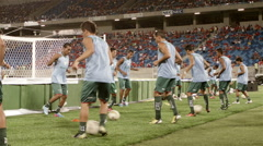 Soccer team warm up with balls Stock Footage