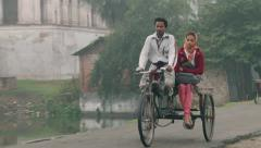 People ride bicycles on a cold foggy morning in Puthia, Bangladesh. Stock Footage