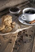 Delicious coffee with sweets on a wooden table Stock Photos
