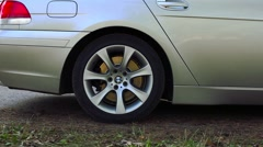Car wheel grinds and darts off Stock Footage