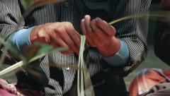 Man cuts bamboo bark to produce bamboo mats, Tangail, Bangladesh. Stock Footage