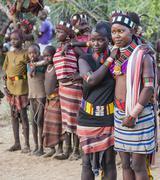 Boys and girls at the traditional evangaty ceremony. Turmi, Ethiopia - stock photo